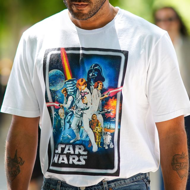 paris, france   june 21 a guest wears a white t shirt with a picture of star wars print, , outside berluti, during paris fashion week   menswear springsummer 2020, on june 21, 2019 in paris, france photo by edward berthelotgetty images