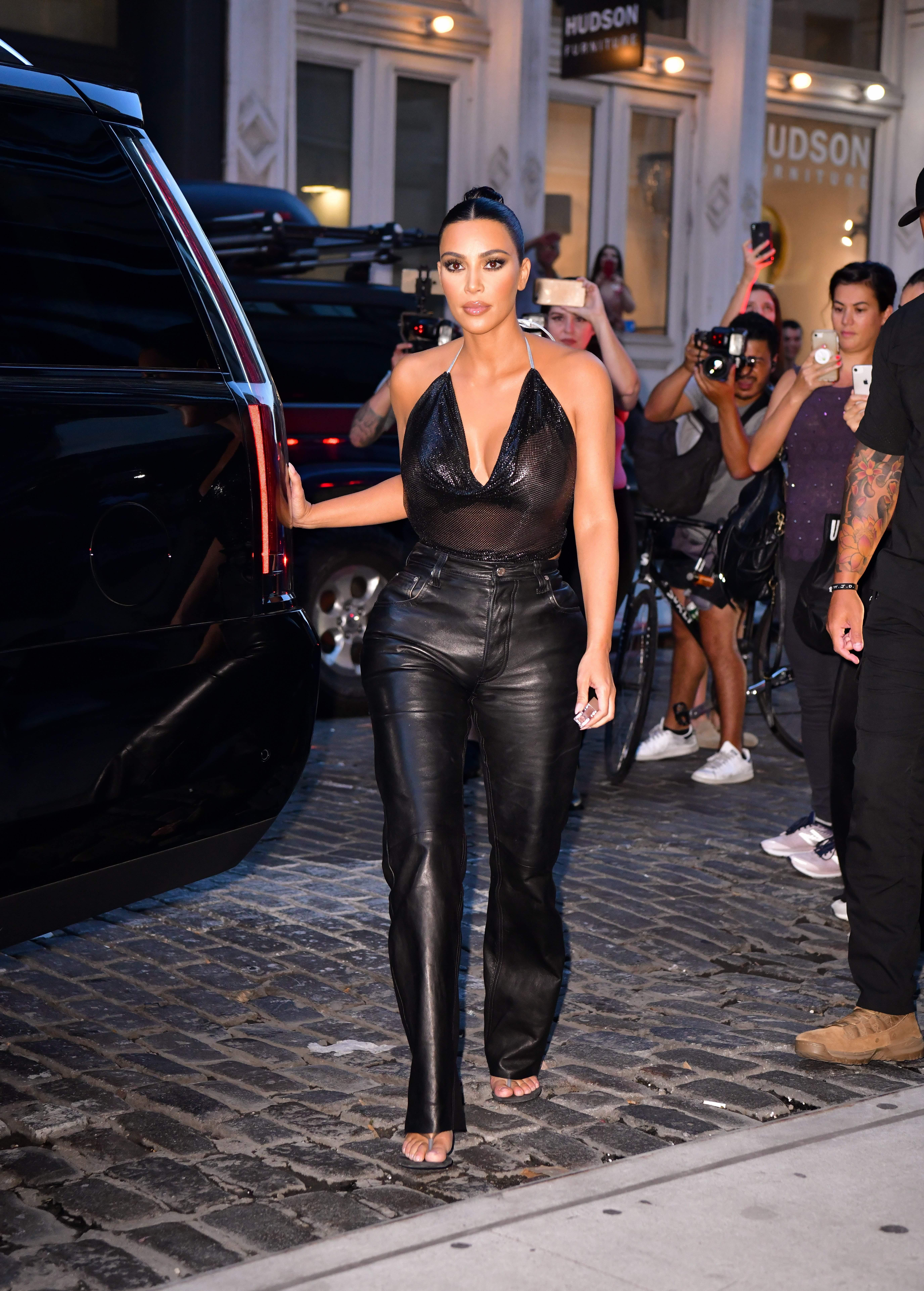 Kim Kardashian's Sheer Halter Top is a Saucy Piece for the End of Summer