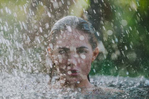 Beautiful girl relaxing in the summer rain. concept about lifestyle,beauty, vacations and real estates