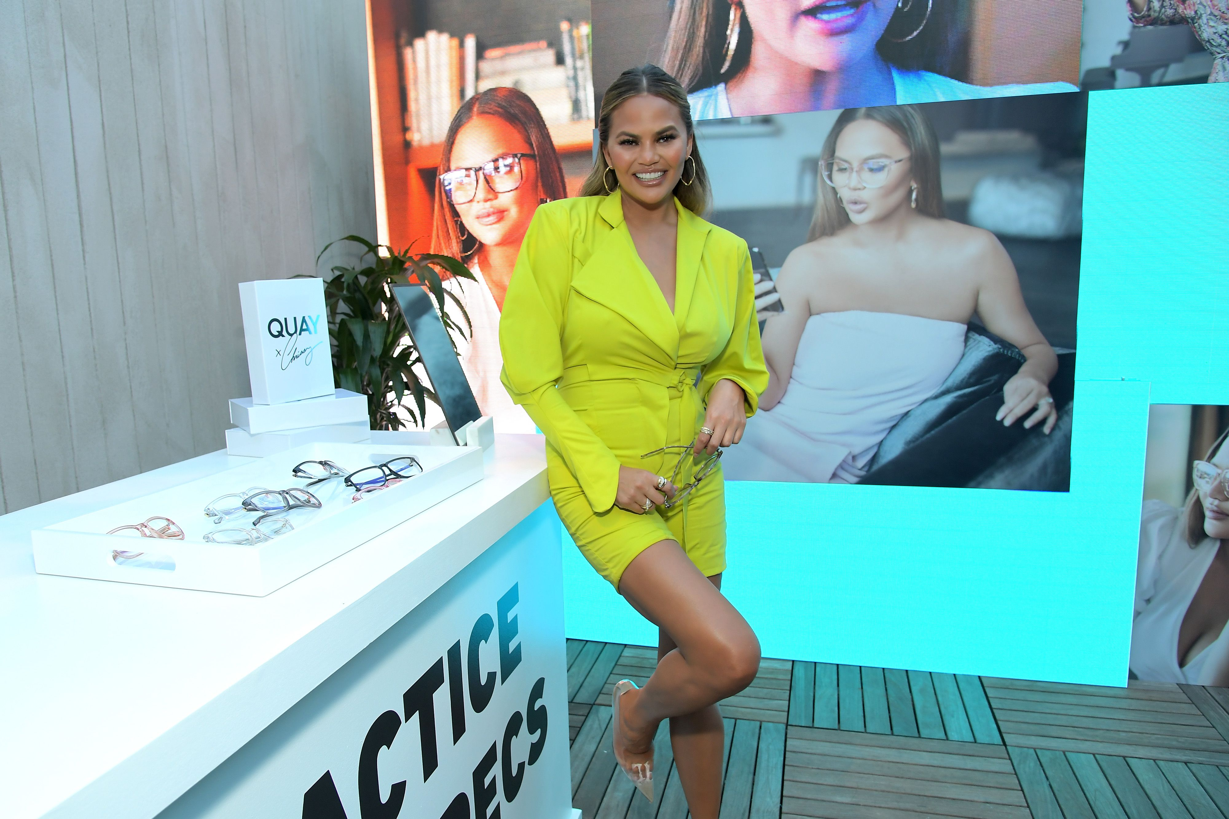 Only Chrissy Teigen Can Pull Off This Short, Long-Sleeved, Neon-Green Romper