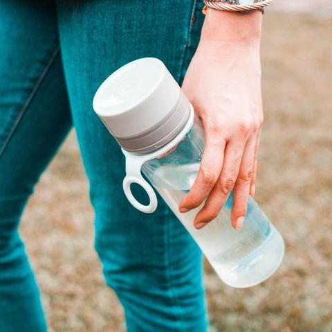 Turquoise, Skin, Water bottle, Water, Hand, Footwear, Leg, Jeans, Shoe, Bottle,