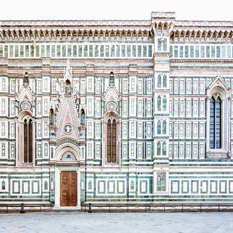 santa maria del fiore cathedral duomo, the lateral southern side with porta del campanile the exterior of the basilica is faced with polychrome marble panels in various shades of green and pink, bordered by white gothic style