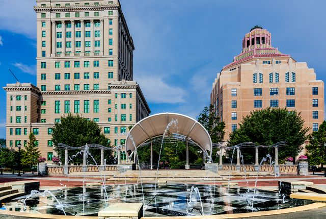 asheville, nc, usa 21 august 2019 the splash pad in pack square, in front of the courthouse, city administration building, and covered stage
