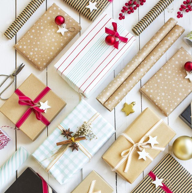 christmas day various gift boxes wrapped with recycling paper placed on white wooden background