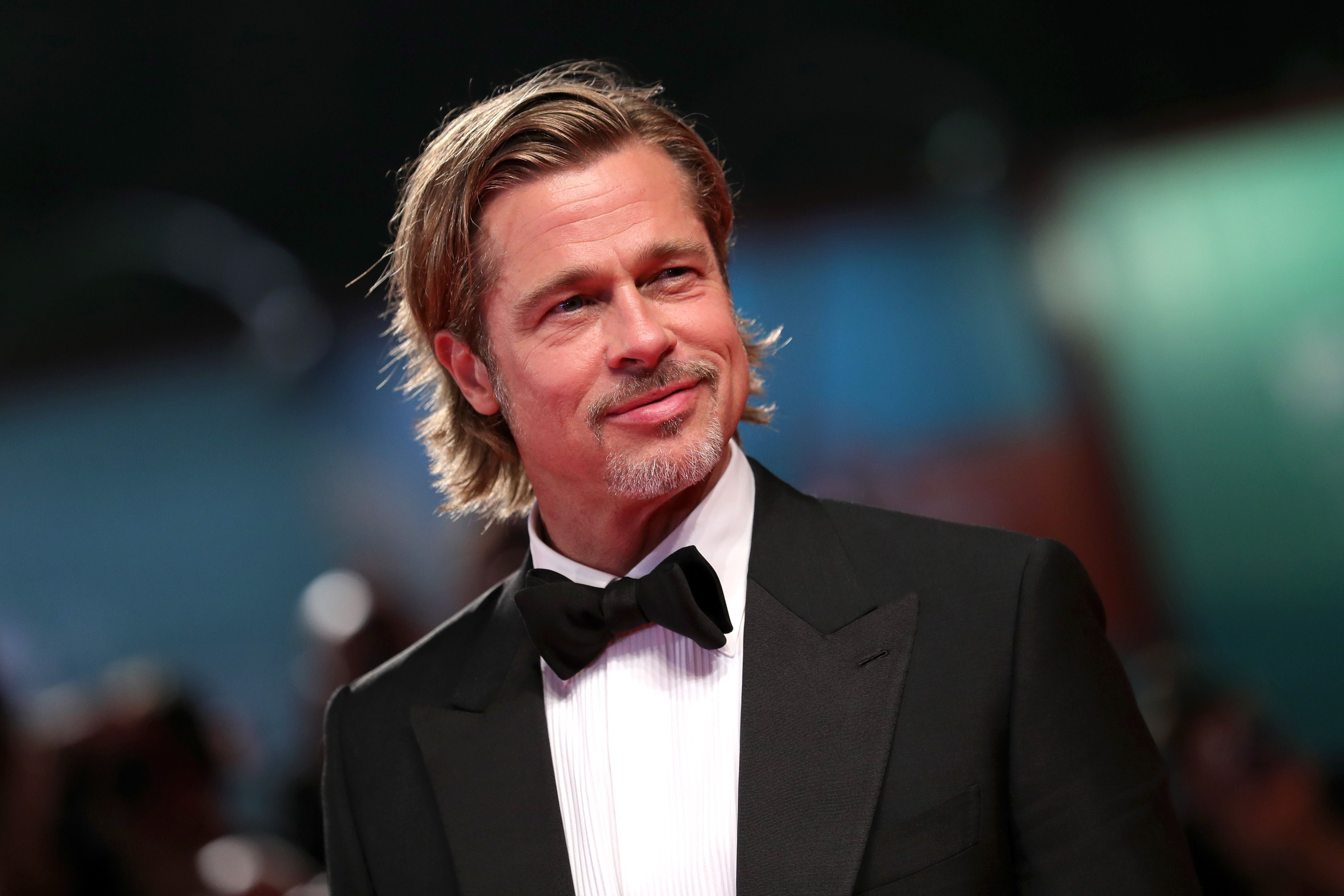 Brad Pitt attends the Oscars luncheon wearing a name tag