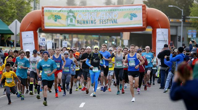 thousands of runners take off from the starting line during the 5k portion of the eighth annual oakland running festival on sunday, april 2, 2017, in oakland, california  over four thousand runners took part in the event which included a full and half marathon, a 5k race, and childrens fun run   aric crabbbay area news group photo by medianews groupbay area news via getty images