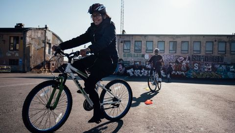 an immigrant woman rides a bike on september 20, 2019 on the gimcana track in merihaka area, in helsinki, finland, as she takes part in the lets ride project offering free cycling lessons   immigrants to finland can receive free cycling lessons to help them better integrate into life in the bike loving nation photo by alessandro rampazzo  afp        photo credit should read alessandro rampazzoafp via getty images