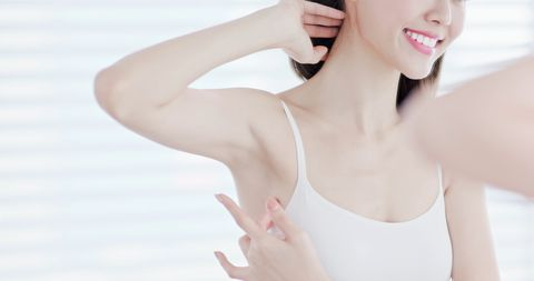 beauty woman smile with clean underarm   hair removal concept