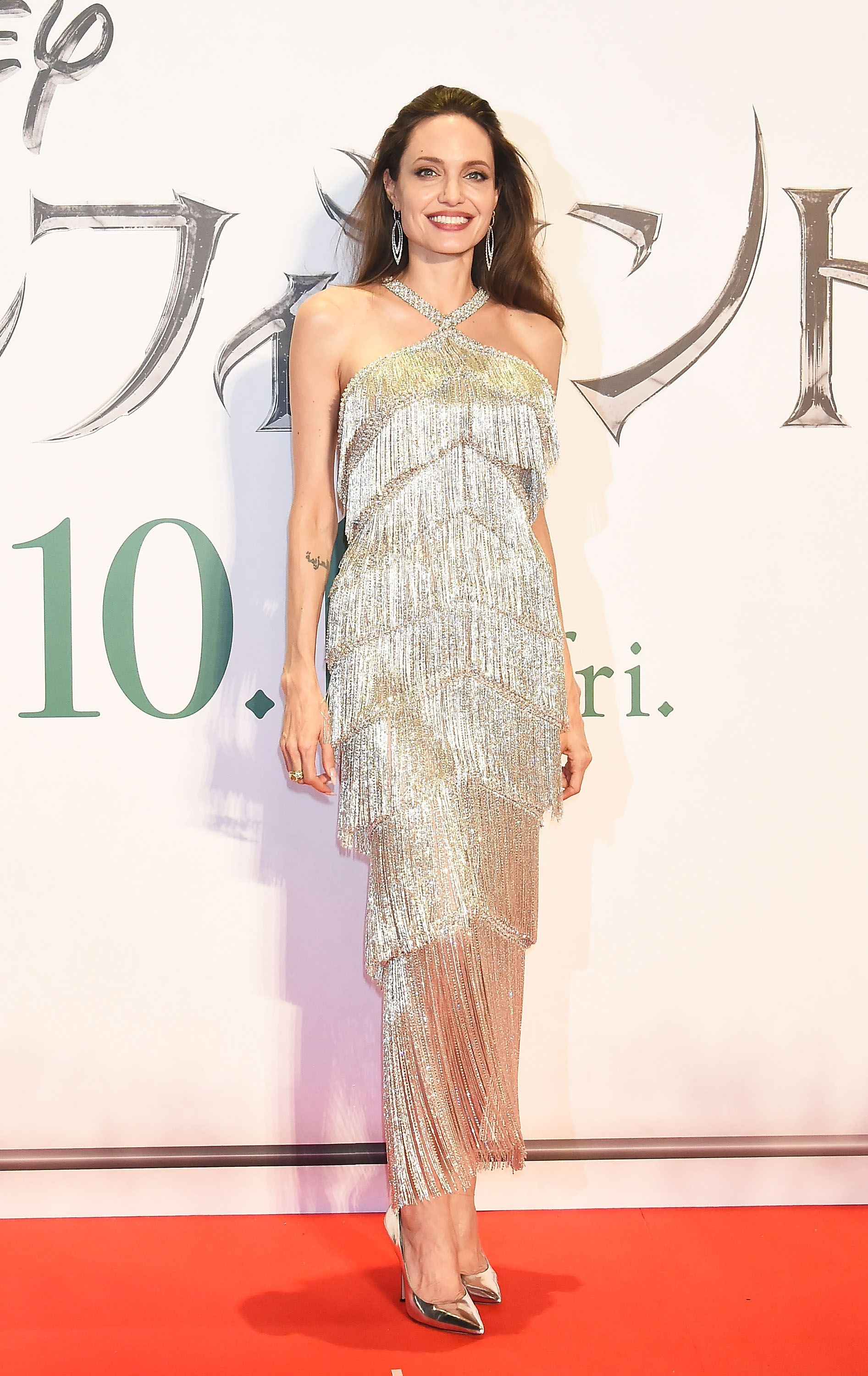 Angelina Jolie Stuns In Metallic Fringe Dress At Maleficent