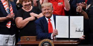 U.S. President Donald Trump signs an executive order to