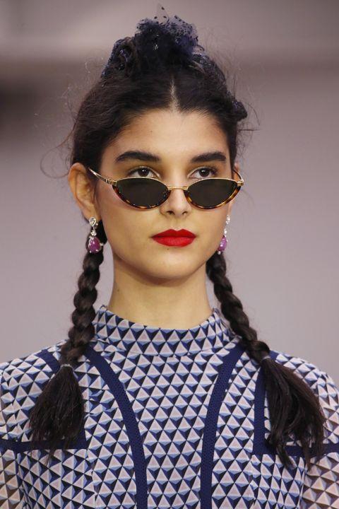 Eyewear, Hair, Face, Lip, Fashion, Fashion model, Hairstyle, Eyebrow, Beauty, Black hair,