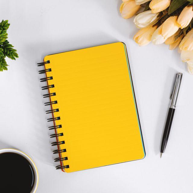 Yellow Notebook and Coffee Mug on Work Desk