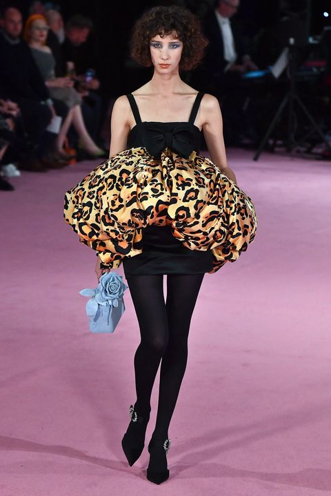 Fashion model, Fashion, Fashion show, Runway, Clothing, Haute couture, Thigh, Human leg, Leg, Shoulder,