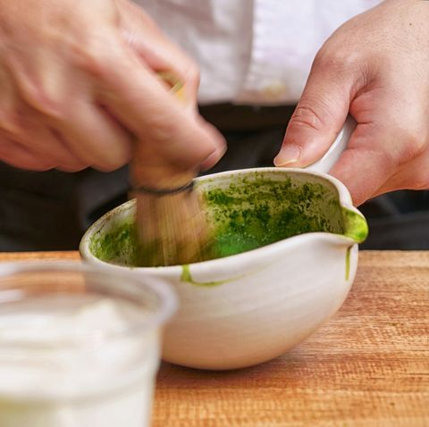 Close up of the traditional way of preparing green tea for macha latte, Japanese tea ceremony, Osaka.