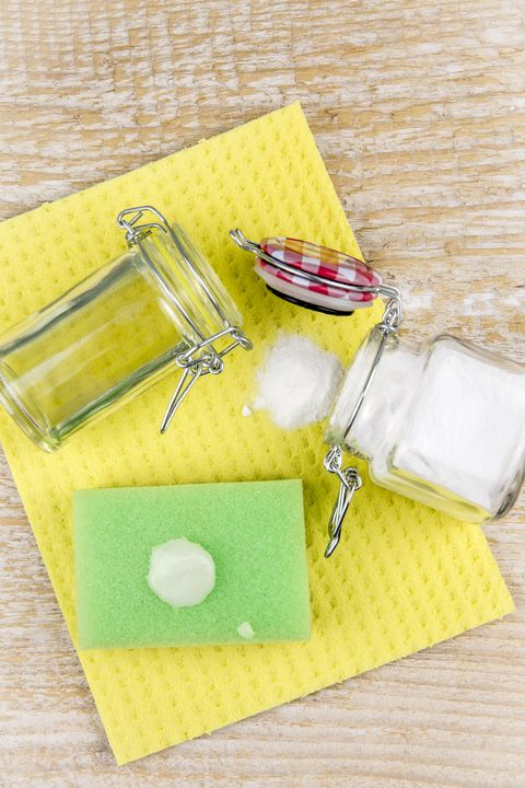 nature and eco friendly natural cleaner  baking soda and olive oil paste on washing sponge for cleaning home, removing stains, non toxic cleaning product concept copy space