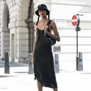 london, england   september 13 model hadija symone wears voltage trainers, kangol bucket hat and black satin dress during london fashion week september 2019 on september 13, 2019 in london, england photo by kirstin sinclairgetty images