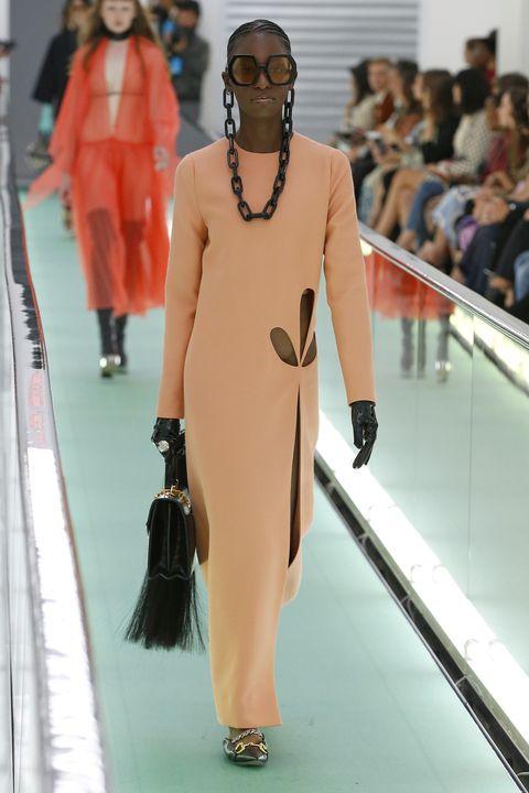 Fashion model, Fashion, Fashion show, Runway, Clothing, Dress, Shoulder, Haute couture, Fashion design, Joint,