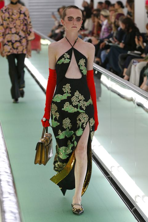 Clothing, Eyewear, Leg, Human, Fashion show, Shoulder, Joint, Human leg, Outerwear, Dress,