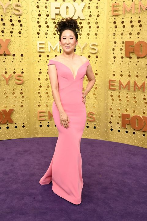 Dress, Clothing, Pink, Shoulder, Gown, Red carpet, Flooring, Formal wear, Lilac, Hairstyle,