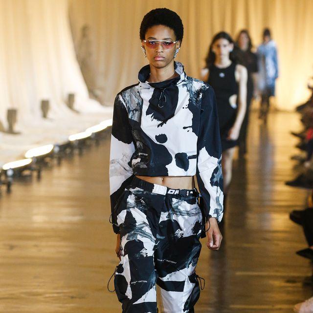 Runway, Fashion, Fashion show, Fashion model, Footwear, Haute couture, Fashion design, Camouflage, Event, Trousers,