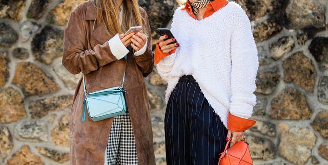 paris, france   september 27 diletta bonaiuti is seen wearing orange mini bag, striped navy pants, white knit outside loewe during paris fashion week womenswear spring summer 2020 on september 27, 2019 in paris, france photo by christian vieriggetty images
