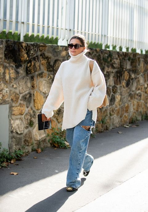 paris, france   september 27 a guest is seen wearing turtleneck knit, ripped denim jeans outside loewe during paris fashion week womenswear spring summer 2020 on september 27, 2019 in paris, france photo by christian vieriggetty images