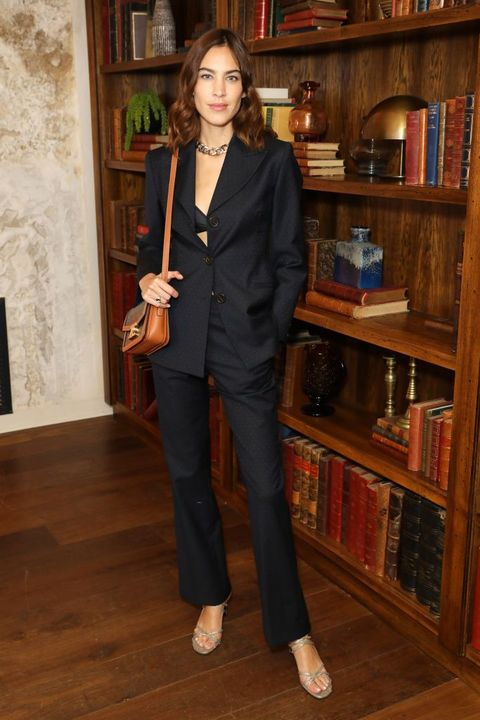 Clothing, Suit, Standing, Pantsuit, Outerwear, Blazer, Formal wear,