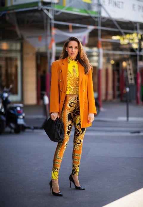 Clothing, Street fashion, Yellow, Fashion, Fashion model, Orange, Snapshot, Outerwear, Footwear, Fashion design,