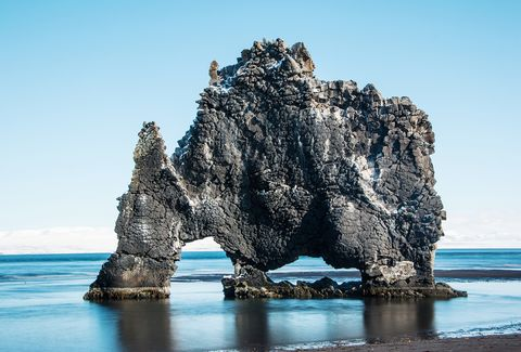 View Of Rock Formation In Sea Against Clear Sky
