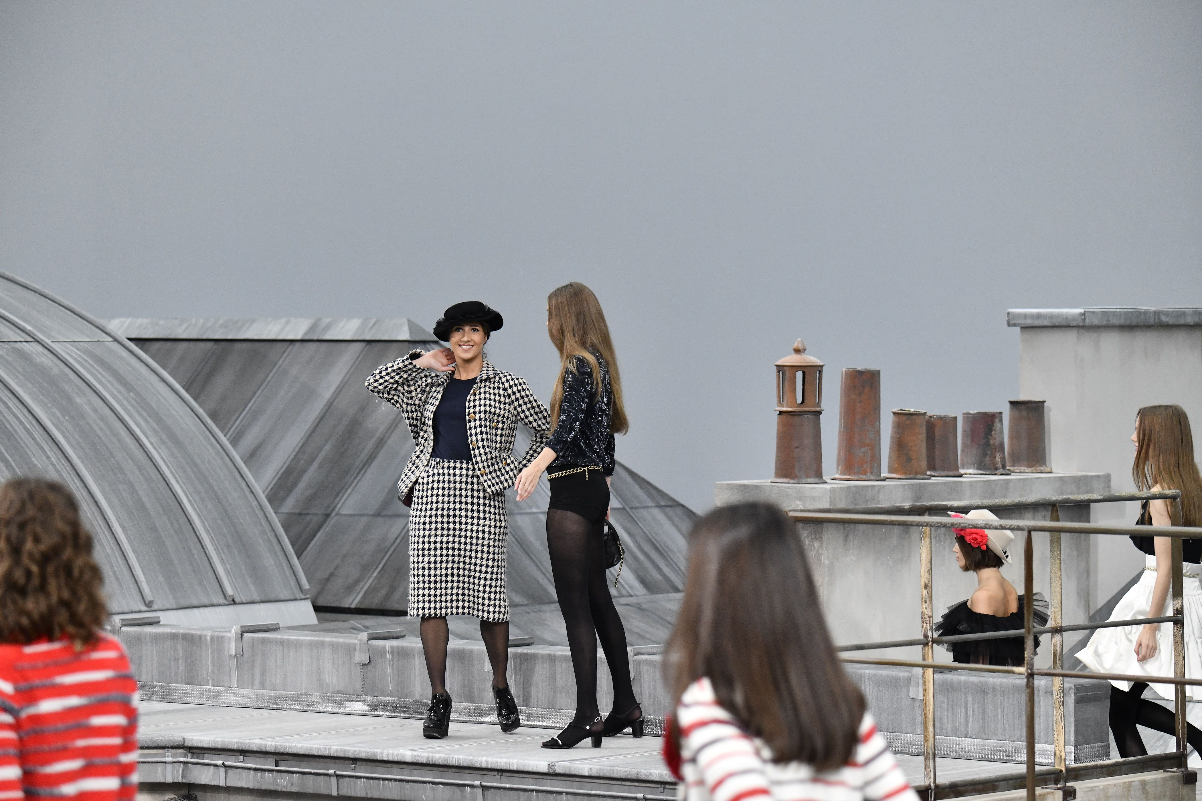 Gigi Hadid Knows How to Handle a Runway Crasher at the Chanel Show