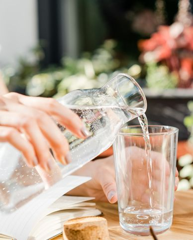 woman pouring a glass of water