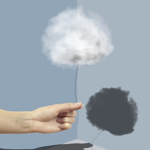 Hand Holding a cloud with a shadow