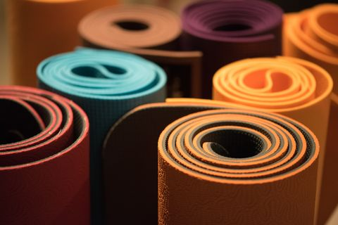 Close-Up Of Multi Colored Rolled Exercise Mats