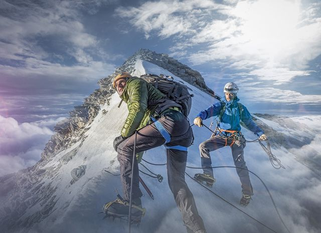 two climber on a snowy slope preparing for the final ascent to the top