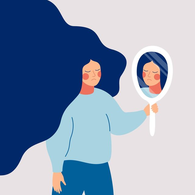 sad young woman looks on her reflection in mirror with sorrow cartoon flat style