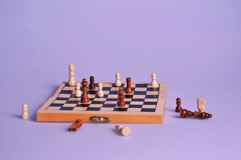 High Angle View Of Chess Board On Purple Background