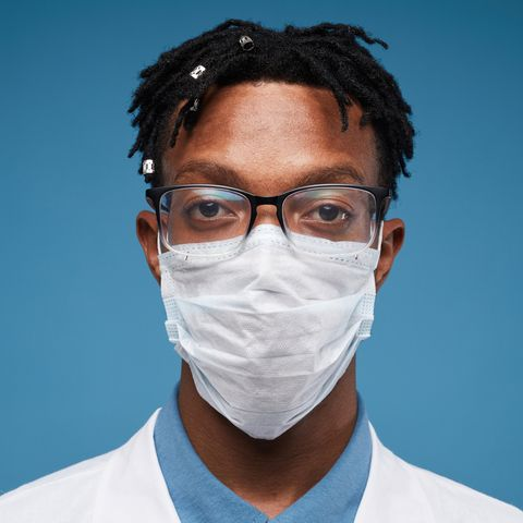 Young African Doctor on Blue