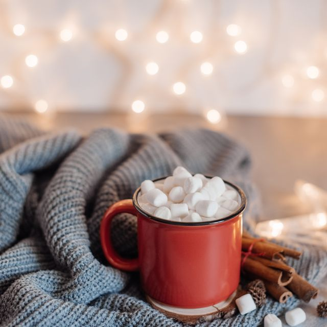 christmas cocoa header with marshmallows, chocolate crumbs, and syrup large coffee cup with homemade hot chocolate winter drink photography on a dark background