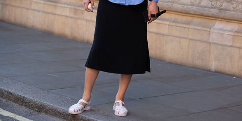 london, england   september 15 model ling chen wears airpods, a blue blouse, black skirt, and light pink jelly sandals after the emilia wickstead show during london fashion week september 2019 on september 15, 2019 in london, england photo by melodie jenggetty images