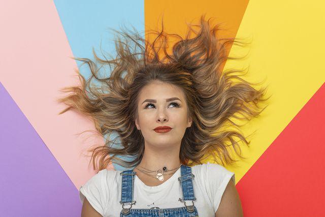 young woman lying on multicolor backgroundstudio shot