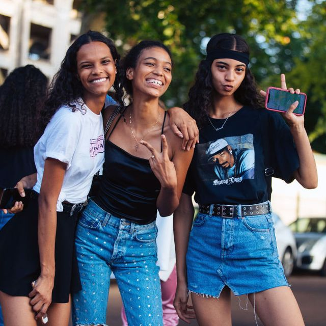 paris, france   june 29  models natalia montero, manuela sancehz, and rocio marconi throw peace signs after the miu miu resort 2020 show on june 29, 2019 in paris, france natalia wears a prada t shirt rocio wears a black headband, black snoop dog t shirt, and denim skirt photo by melodie jenggetty images