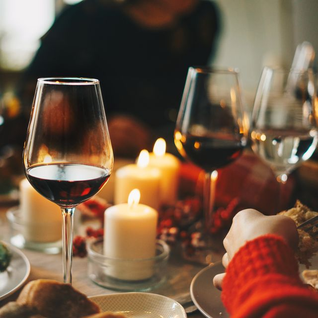 red wine glasses at the decorated dinner table