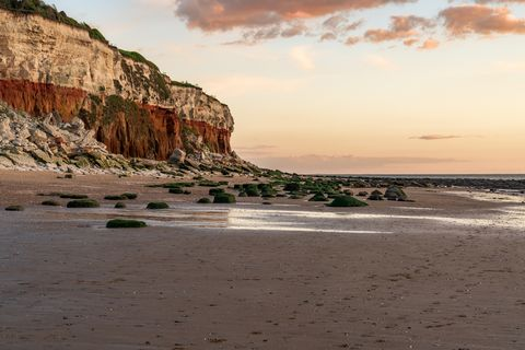 the wreck of the steam trawler sheraton in the evening light at the hunstanton cliffs in norfolk, england, uk