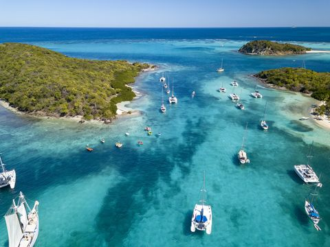 Sail boats and catamarans moored near uninhabited islands of Tabago Cays, Grenadines, 2019