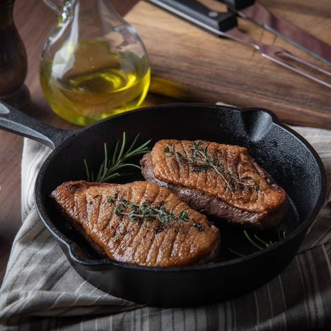 grilled duck breast meat with skillet