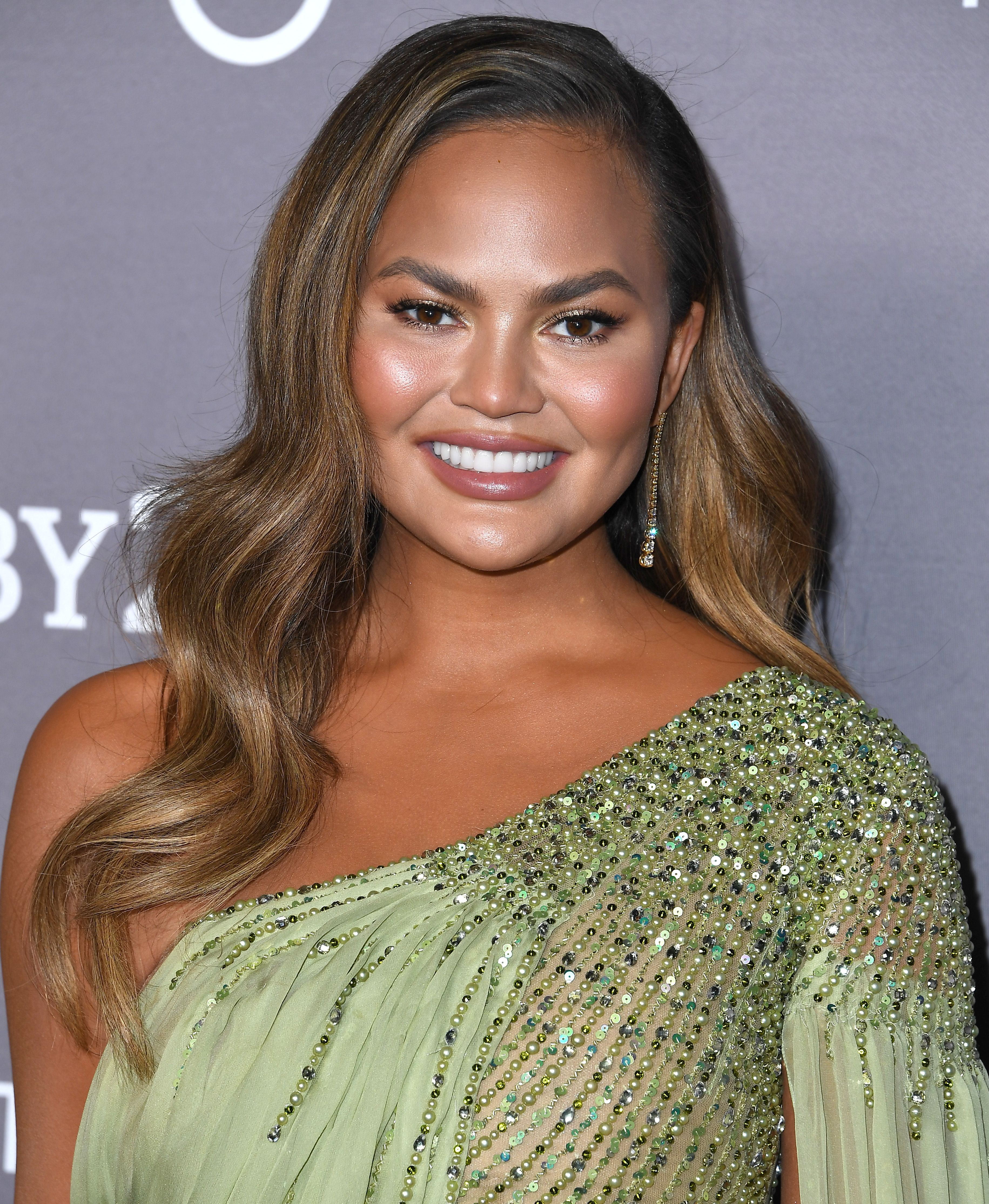 Chrissy Teigen's transformed her hair just in time for Christmas