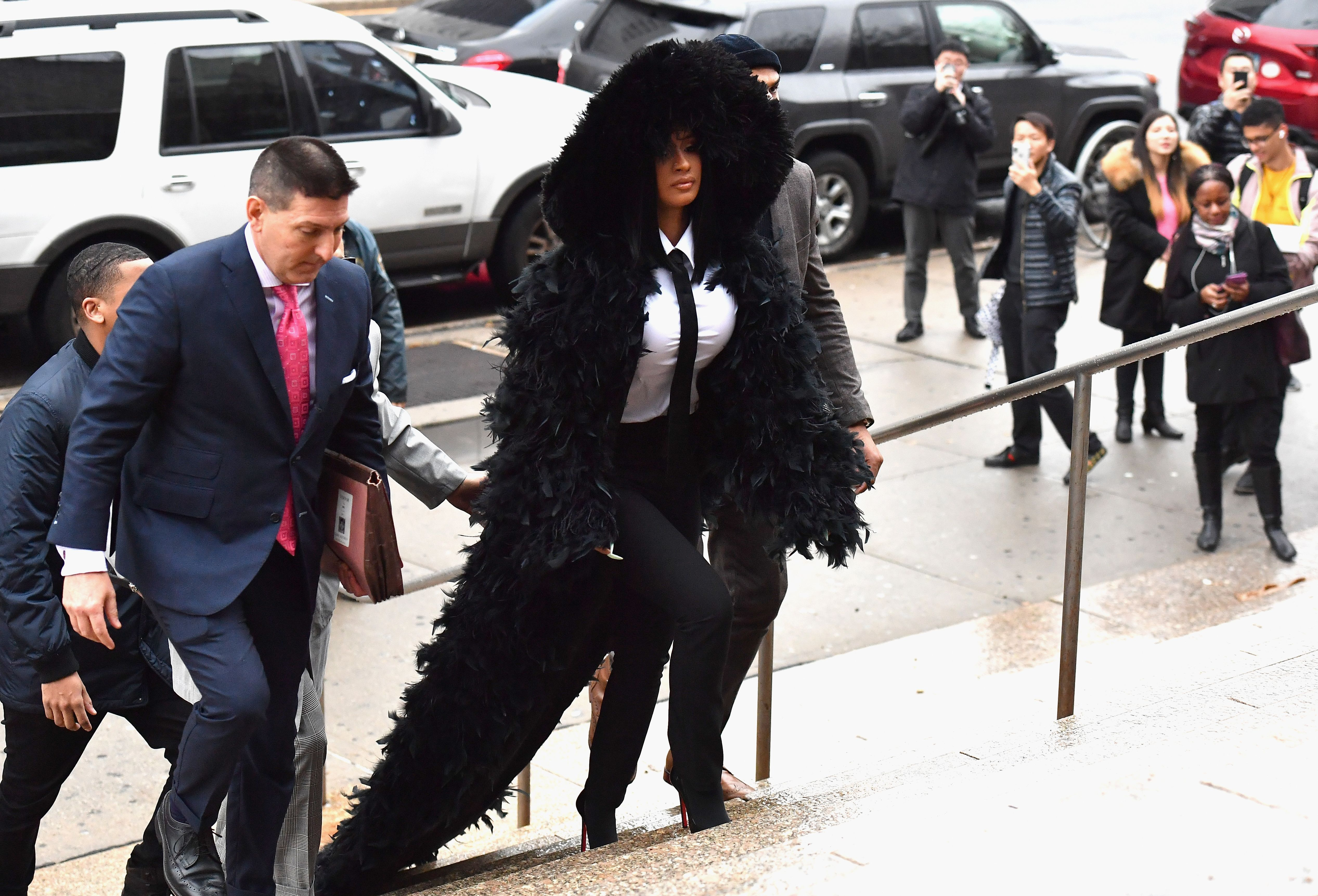 Cardi B. Showed Up to Court In a Feather-Laden Black Coat With a Train