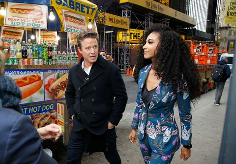 new york, new york   november 18 billy bush and miss usa 2019 cheslie kryst enjoy a hot dog in times square during extra at the levis store times square on november 18, 2019 in new york city photo by john lamparskigetty images