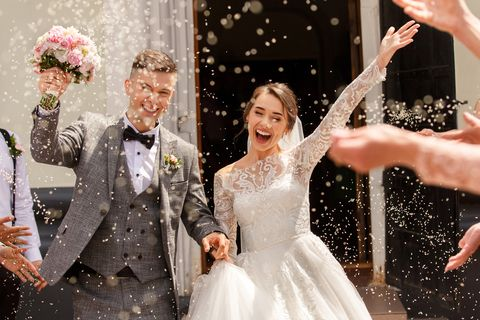 happy wedding photography of bride and groom at wedding ceremony wedding tradition sprinkled with rice and grain