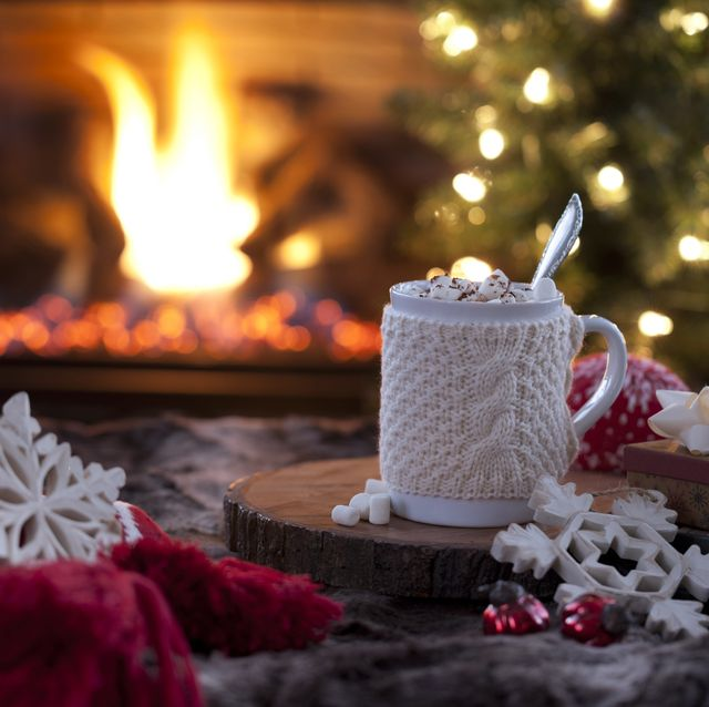 christmas cozy hot chocolate in front of the fireplace